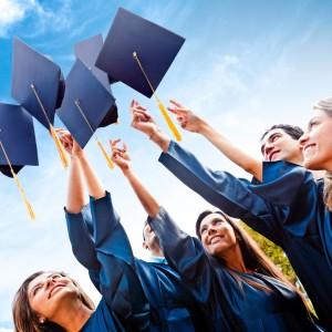 Students throwing graduation hats